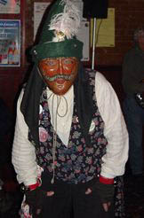Wooden masked Narren dancer in New Ulm, MN - photo by Lucy Saunders