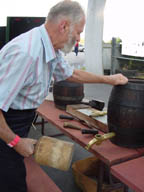 Ernst Frankenberg, tapping old beer barrels at a Museum of Beer and Brewing Fundraiser; photo by Lucy Saunders